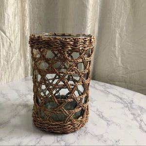 Blue glass vase with wicker basket holder